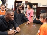 Carlos Dunlap talks with kids on his anti-bullying tour.