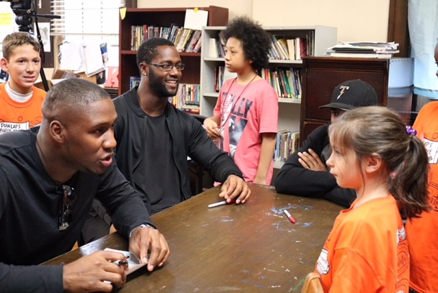 Carlos Dunlap talks with kids on his anti-bullying tour. Image courtesy of the Carlos Dunlap Foundation.