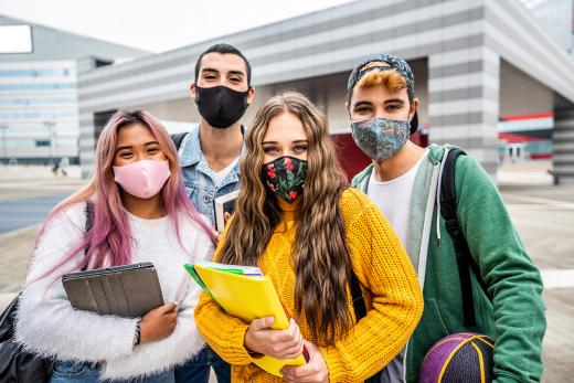 A group of students wearing face masks at school.